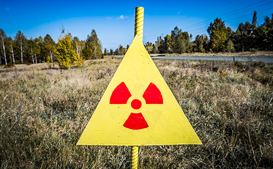 Ionizing Radiation sign next to Red Forest in Chernobyl Nuclear Power Plant Zone of Alienation, Ukraine