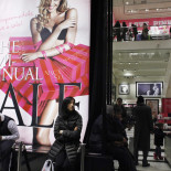 Shoppers rest inside Victoria Secret store at middle Manhattan in New York, January 12, 2012. U.S. retail sales rose at the weakest pace in seven months in December and first-time claims for jobless benefits moved higher last week, signs the economic recovery remains shaky despite a pick-up in growth. REUTERS/Eduardo Munoz (UNITED STATES - Tags: BUSINESS TEXTILE) - RTR2W7FQ