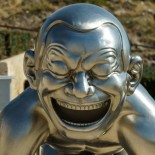 art_sculpture_metal_silver_chrome_laughing_boy_man_smiling-788454