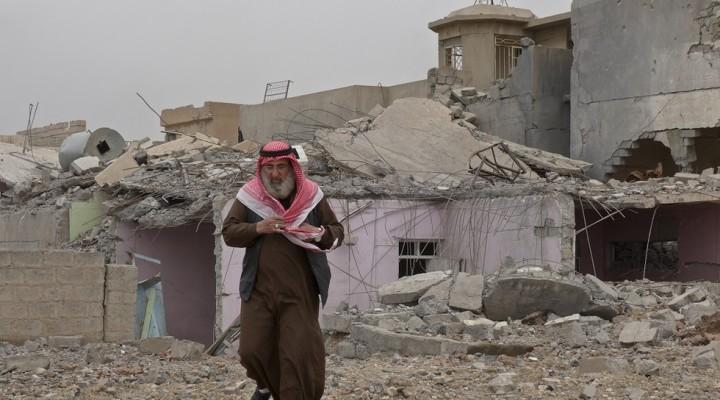 AbuAhmedwalksfromtherubblehishousewasreducedtobyanallegedcoalitionairstrike(MEETomW