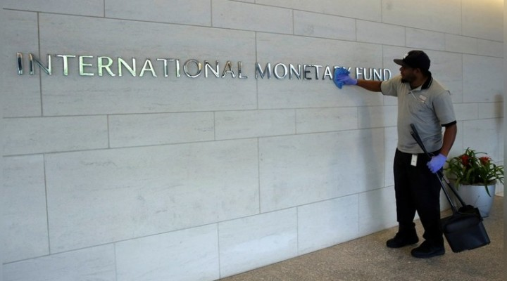 A facilities maintenance staff member cleans signage at International Monetary Fund headquarters building during the IMF/World Bank annual meetings in Washington, U.S., October 14, 2017. REUTERS/Yuri Gripas - RC17E15189F0