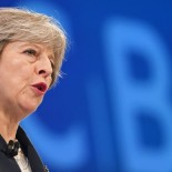 epa06311396 British Prime Minister Theresa May delivers a speech at the annual CBI (Confederation of British Industry) conference in London, Britain, 06 November 2017. Labour party leader Corbyn is scheduled to address the CBI later the day, too.  EPA-EFE/ANDY RAIN