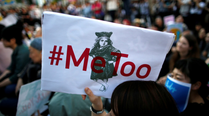 "A protester raises a placard reading ""#MeToo"" during a rally against harassment at Shinjuku shopping and amusement district in Tokyo, Japan, April 28, 2018. Picture taken April 28, 2018.   REUTERS/Issei Kato - RC17E70704F0"
