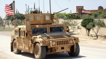 FILE PHOTO:The U.S. flag flutters on a military vehicle in Manbej countryside, Syria May 12, 2018. REUTERS/Aboud Hamam/File Photo - RC19358309D0