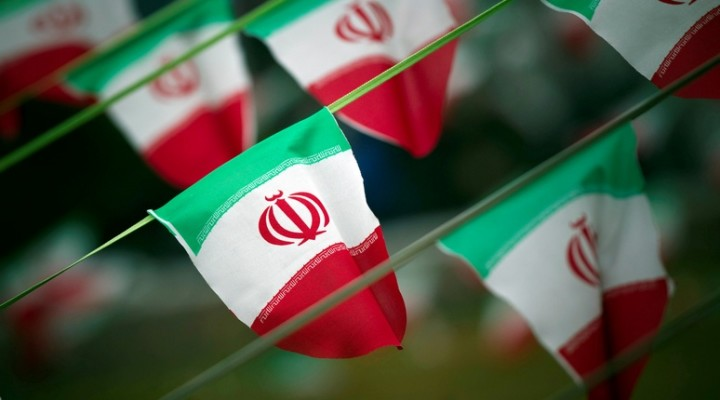 FILE PHOTO: FILE PHOTO: Iran's national flags are seen on a square in Tehran February 10, 2012, a day before the anniversary of the Islamic Revolution. REUTERS/Morteza Nikoubaz/File Photo