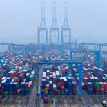 FILE PHOTO - Containers and trucks are seen on a snowy day at an automated container terminal in Qingdao port, Shandong province, China December 10, 2018, REUTERS/Stringer/File Photo ATTENTION EDITORS - THIS IMAGE WAS PROVIDED BY A THIRD PARTY. CHINA OUT. GLOBAL BUSINESS WEEK AHEAD