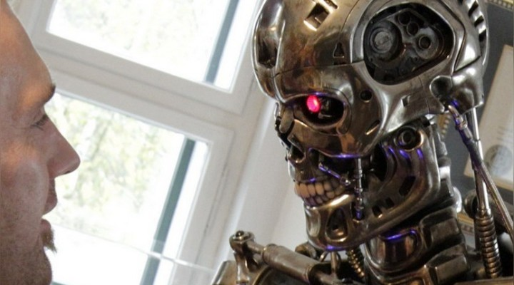A visitor looks at a robot figure from the movie 'the Terminator', inside the house where Austrian actor, former champion bodybuilder and former California governor Arnold Schwarzenegger was born, in the southern Austrian village of Thal, October 7, 2011. Schwarzenegger officially opened a museum dedicated to his life in the house on Friday. REUTERS/Herwig Prammer  (AUSTRIA - Tags: ENTERTAINMENT PROFILE) - RTR2SCBE