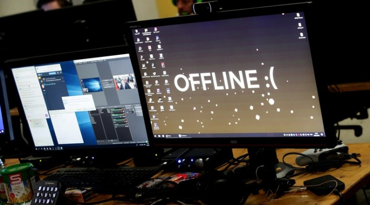 "A computer desktop with wallpaper that reads ""Offline"" is pictured during the Electronic Sports Festival, Austria's largest LAN Party in Vienna, March 29, 2019. Picture taken March 29, 2019. REUTERS/Lisi Niesner"