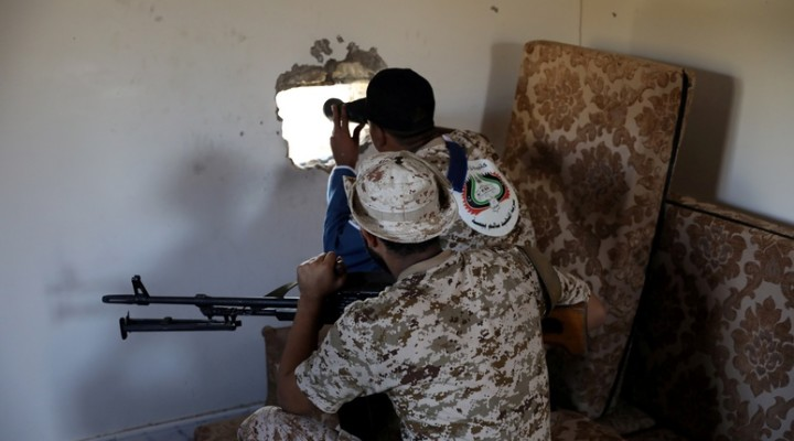 FILE PHOTO: Members of the Libyan internationally recognised government forces take their positions in Ain Zara, Tripoli, Libya October 14, 2019. Picture taken October 14, 2019. REUTERS/Ismail Zitouny/File Photo