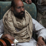 Saif al-Islam is seen after his capture, in the custody of revolutionary fighters in Obari, Libya November 19, 2011. Libya's prime minister-designate said Saif al-Islam would receive a fair trial in Libya. That could lead to conflict with the Hague-based International Criminal Court, which has indicted Saif al-Islam for crimes against humanity. Picture taken November 19, 2011.  REUTERS/Ammar El-Darwish (LIBYA - Tags: POLITICS CIVIL UNREST TPX IMAGES OF THE DAY) - GM1E7BM023601