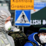 A man wearing a protective face mask stands on the Poland-German border crossing point after the Polish government decided to close its borders to foreigners as a preventive measure against the coronavirus (COVID-19) on the city bridge to Slubice, Poland in Frankfurt/Oder, Germany March 15, 2020. REUTERS/Annegret Hilse