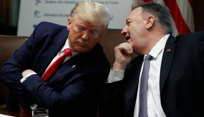 epa07939187 US President Donald J. Trump listens to Secretary of State Mike Pompeo during a Cabinet Meeting at the White House in Washington, DC, USA, 21 October 2019.  EPA-EFE/Yuri Gripas / POOL