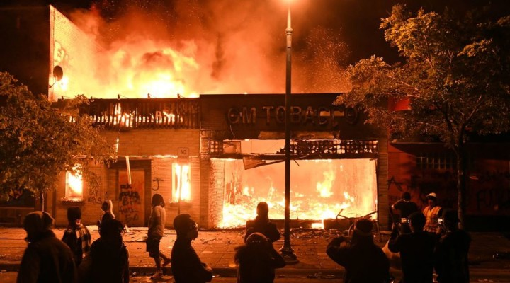 The GM Tobacco store is seen in flames near the Minneapolis Police third precinct during the third day of demonstrations in response to the death of African-American man George Floyd in Minneapolis, Minnesota, U.S. May 28, 2020. REUTERS/Nicholas Pfosi - RC27YG9314C5