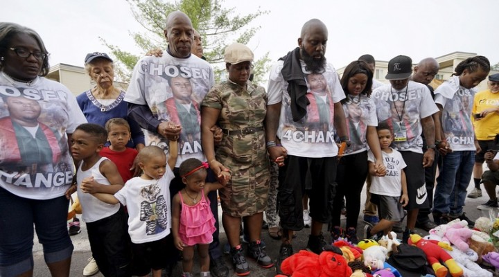 Michael Brown Sr., (4th R) father of Michael Brown who was killed by a Ferguson police officer in 2014, and other family members pray at a memorial to Brown before a protest march in Ferguson, Missouri August 8, 2015. One year after the police shooting of an unarmed black teen thrust Ferguson into the national spotlight, the St. Louis suburb is bracing for a weekend of protests over continued complaints of police violence. REUTERS/Rick Wilking